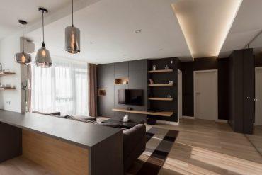Двустаен апартамент с модерен интериор в тъмни цветове