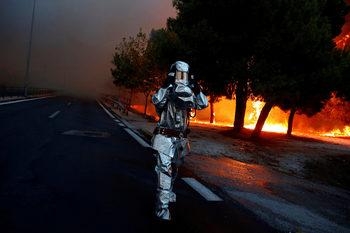Фотогалерия: Огнено бедствие в Гърция